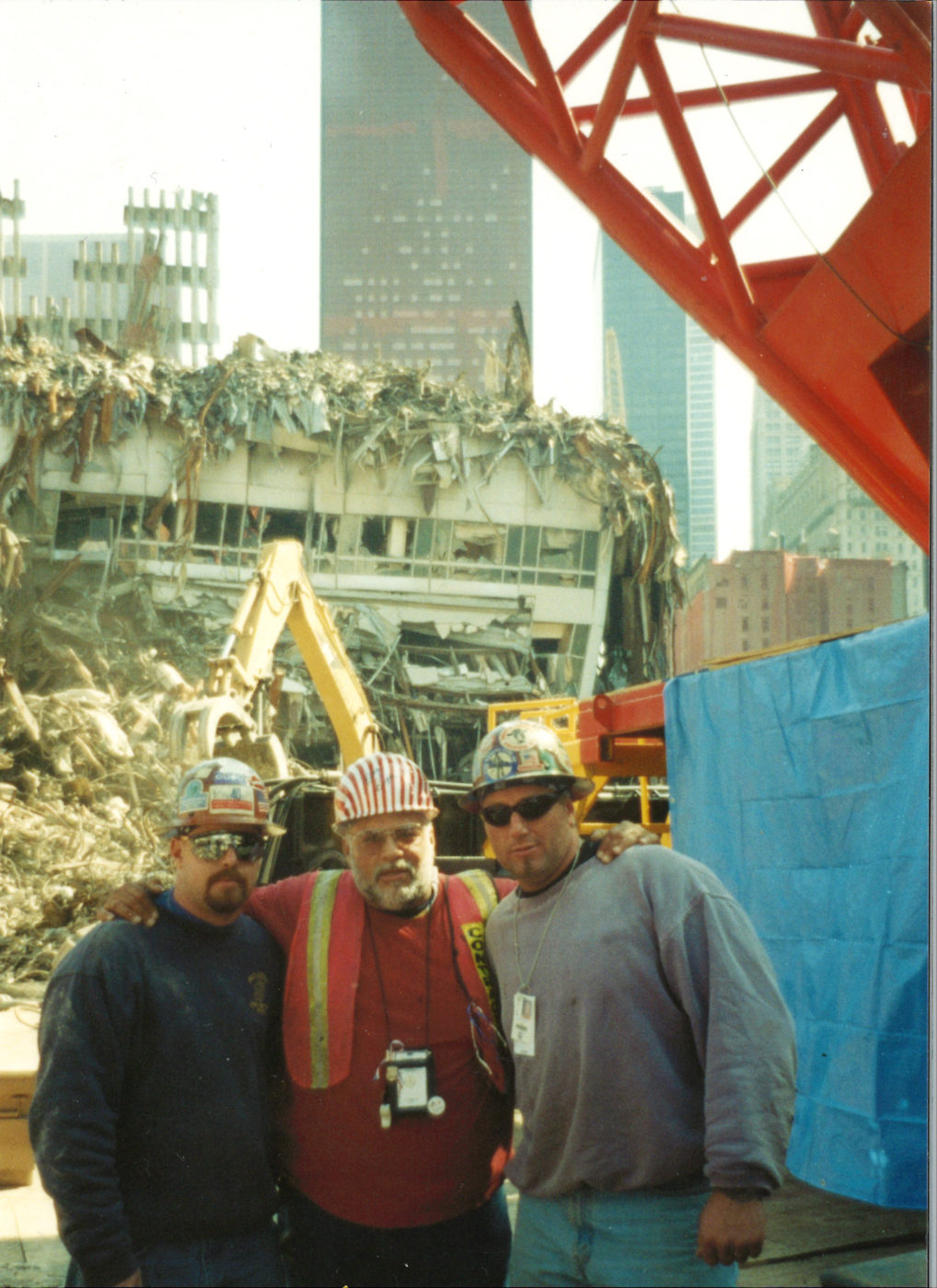 Workers in front of destroyed Marriot Hotel