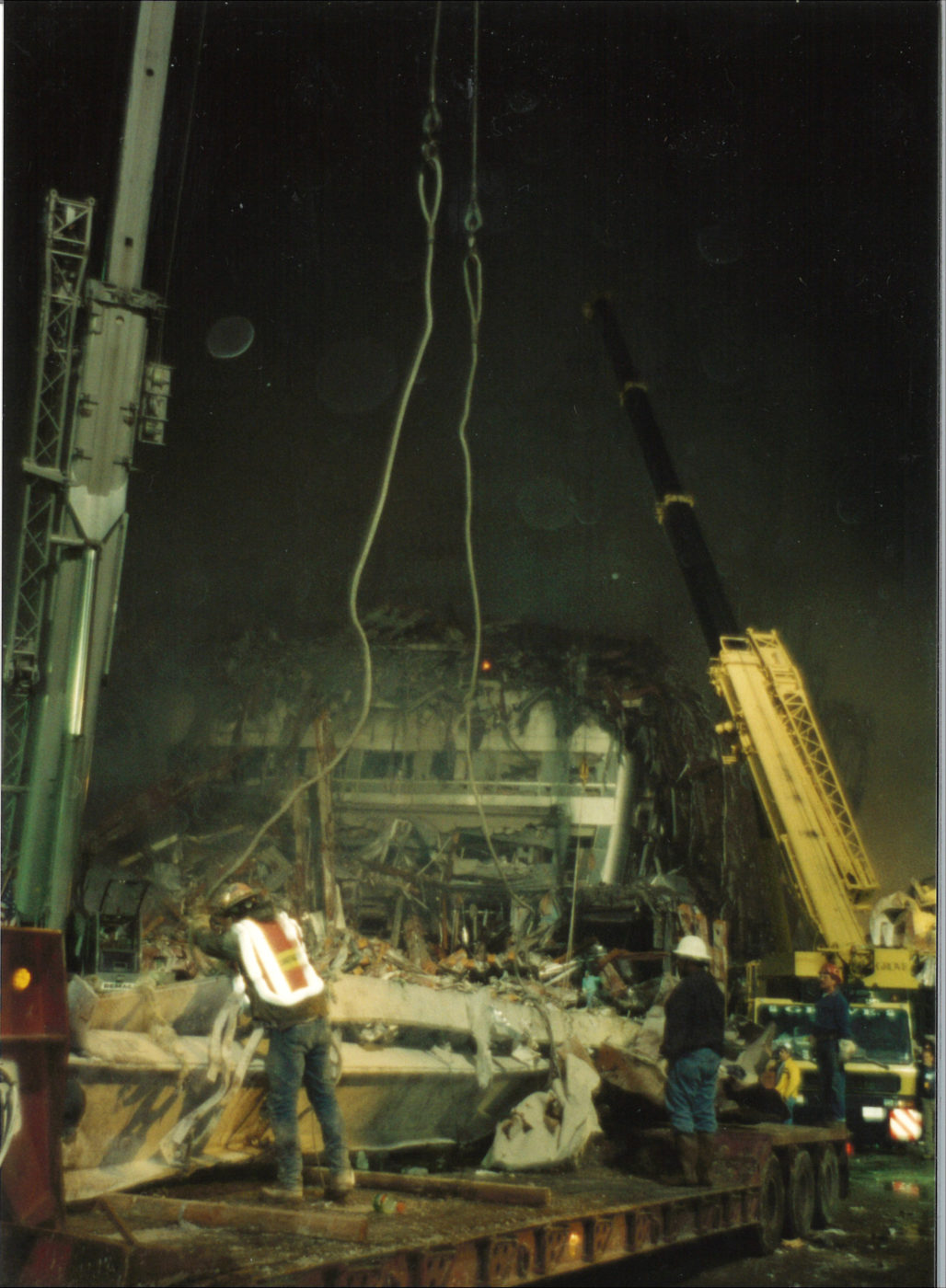 Workers loading a flatbed with debris at Ground Zero