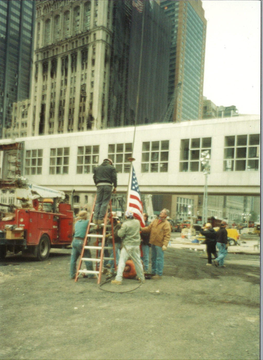 Workers Putting American Flag on a Hoist at Ground Zero