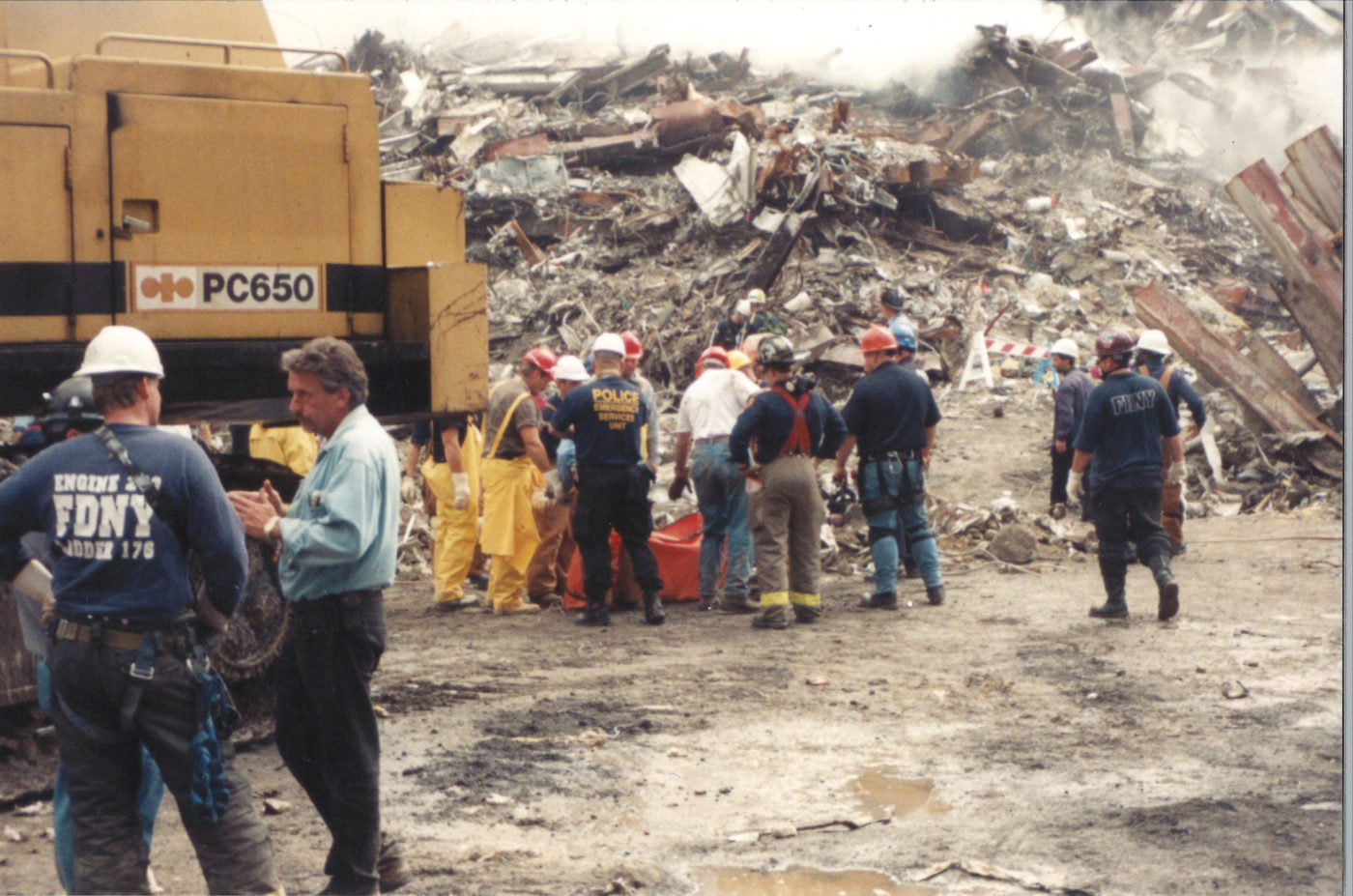 Workers, Police and Fireman Assesing the Debris