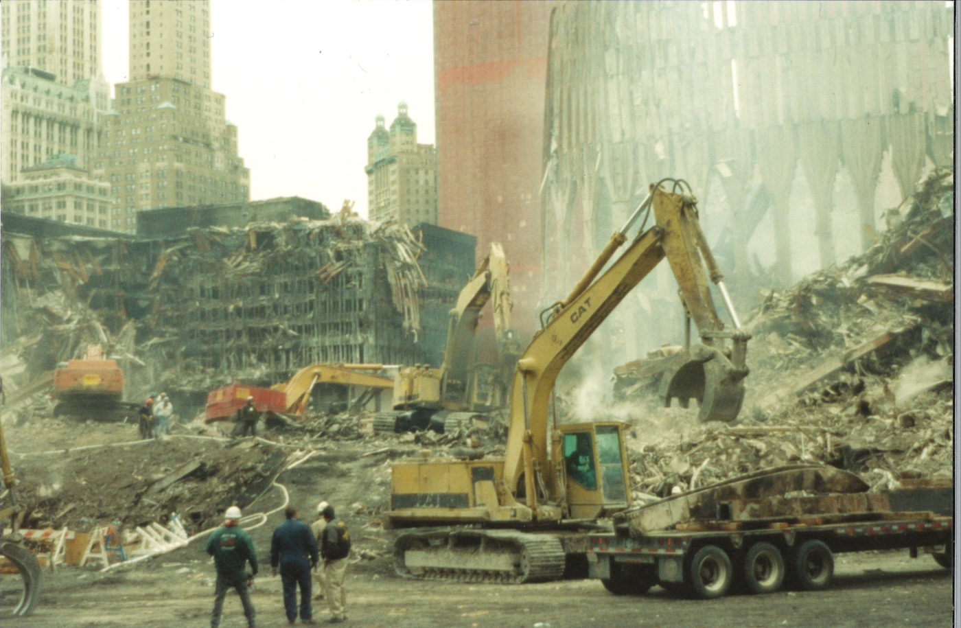 Worrkers on the Pile with destroyed WTC Tower and WTC 5 in background