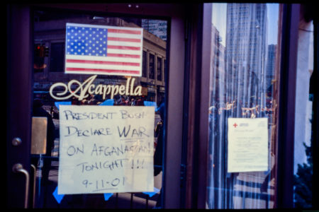 A Sign on the Front Window of Acapella Demands That Bush _Declare War on Afghanastan Tonight 9-11-01_.jpg