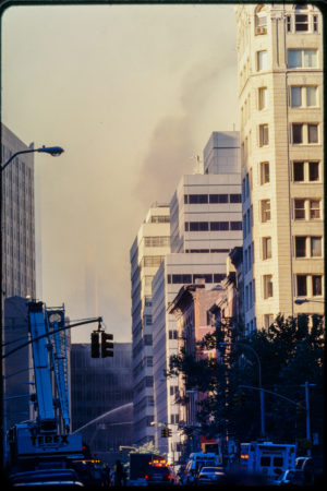 Ambulances, Construction Vehicles, and Fire Department Vehicles Line the Street Leading Up to the Smoking Wreckage.jpg