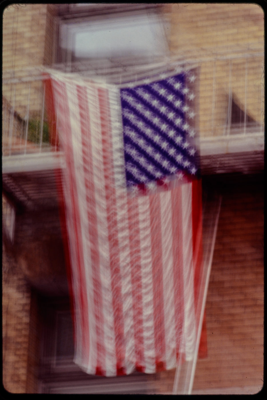 American Flag Hung on Unknown Fire Escape in Motion.jpg