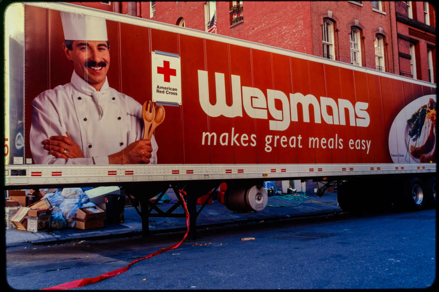 An American Red Cross Truck with a Wegmans Advertisement on its Side, Red Tape Trailing From Truck Says Danger Asbestos.jpg