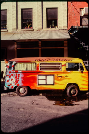 Colorful Parked Van with WWW.2-ZEKO.COM Spray Painted Near the Roof.jpg
