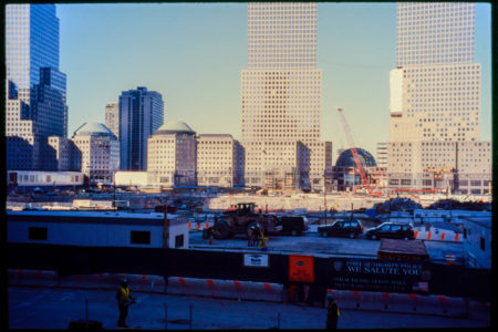 Construction Workers and Vehicles Work Behind Barricades at the WTC.jpg