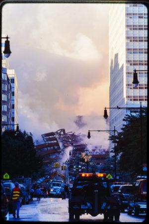 Emergency Vehicle Driving Down Greenwich St Toward Falling WTC5.jpg