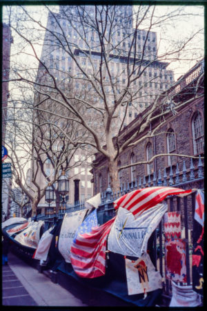 Fence of Church Lined with Messages of Support and American Flags.jpg