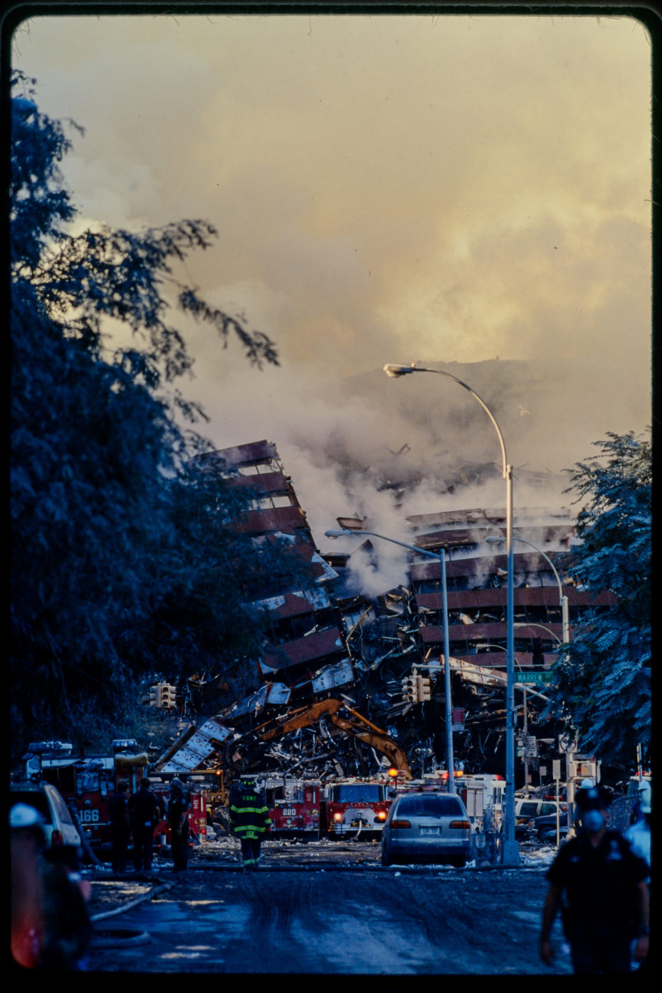 Firefighters and Digger working at Collapsed WTC5.jpg