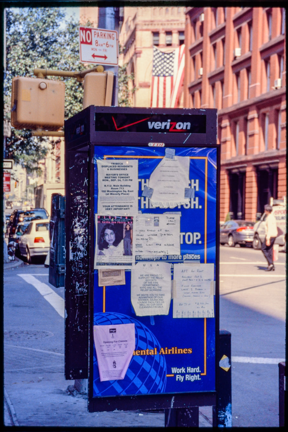Flyer Ads for Apartments, Missing Persons, and Yoga on a Phone Box.jpg