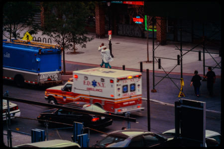 Hospital Workers Pass Dry Cleaner and Parking Lot on Greenwich Street.jpg