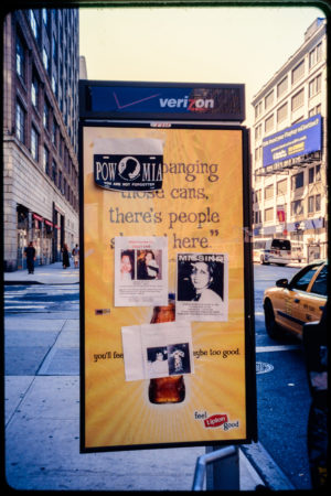 Missing Loved Ones and The National League of Families Flag Advertised on Flyers Attached to a Phone Box Lipton Ad.jpg
