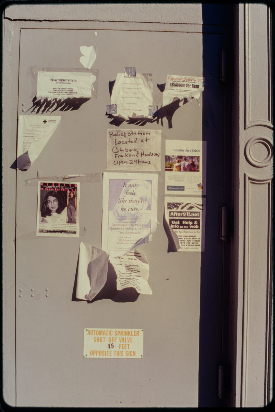 Missing Persons, Relief Station, and Support Groups Advertised on Wall.jpg