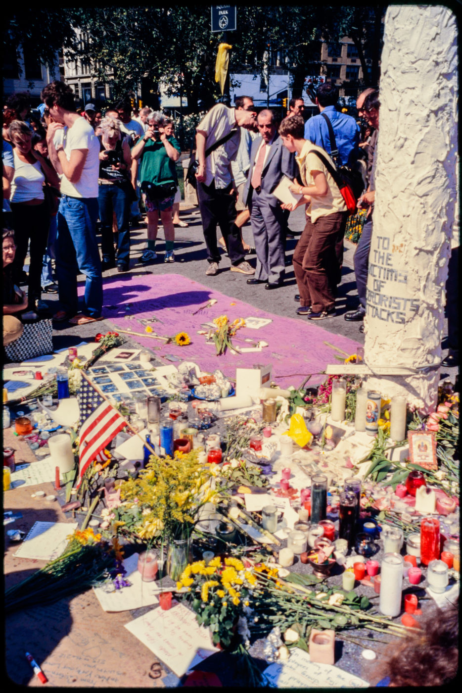 New Yorkers Stand by Memorial Flowers and Candles in Union Square Park.jpg