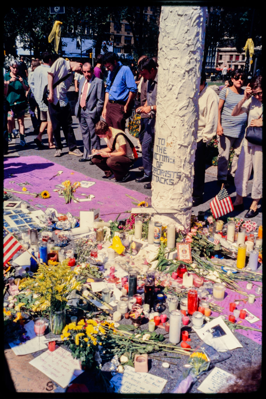 New Yorkers Standing by Prayer Candles and Flowers for Victims of Attack in Union Square.jpg