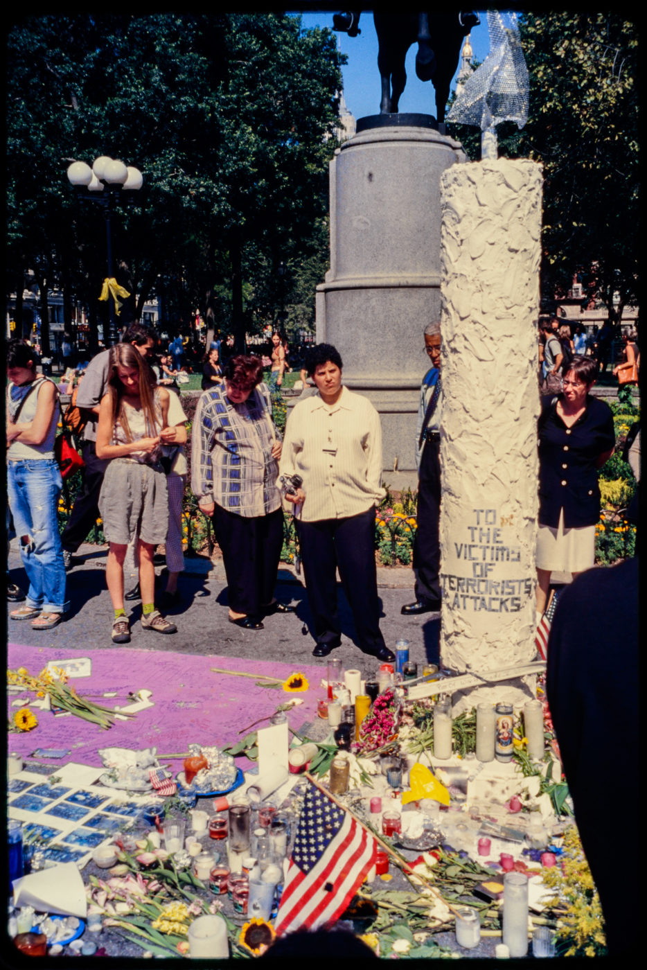 New Yorkers Visit Memorial for Victims of Attack in Union Square Park Beneath George Washington Statue .jpg