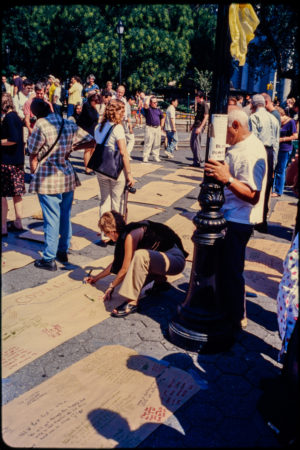 New Yorkers Visit Union Square Park Memorial, One Unknown Individual Contributes a Message for the Victims of the Attack on Cardboard.jpg