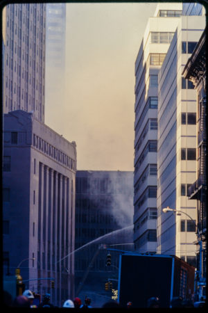 New Yorkers Watch as Hose Combats the Smoke.jpg