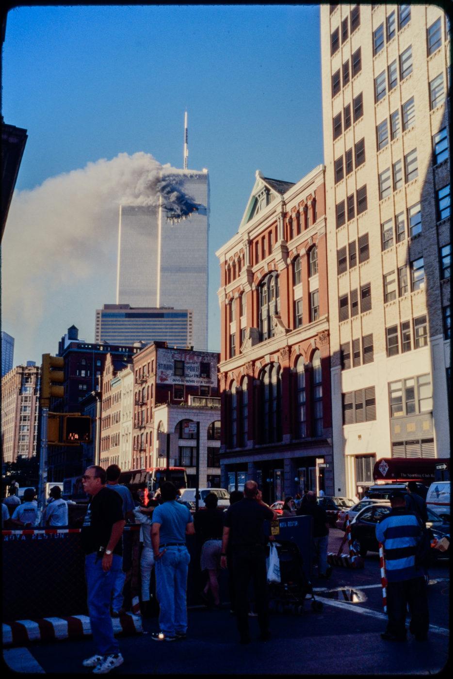 New Yorkers Watch in Disbelief as Tower 1 Burns.jpg