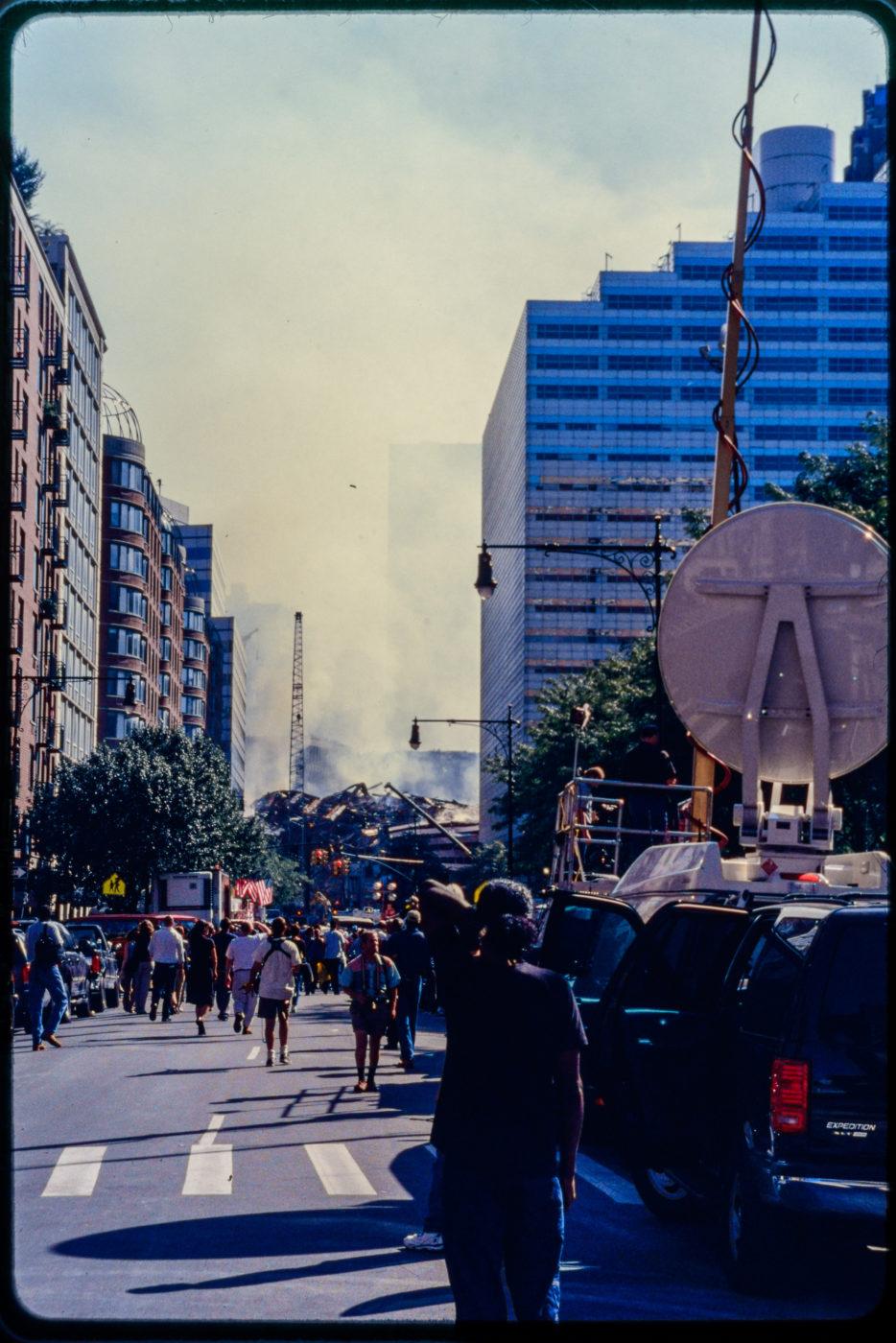 New Yorkers Witness The Smoking Wreckage near Greenwich Street.jpg