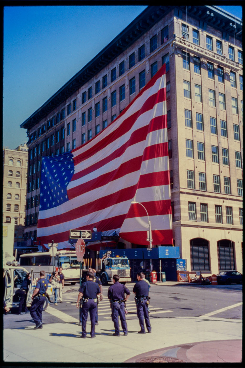Passerby and Police Smile Near American Flag at Hubert and Greenwich Streets.jpg