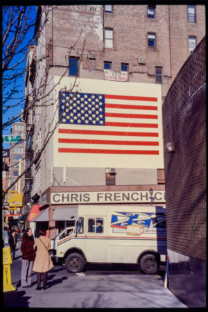 Pedestrians and a Postal Service Truck Outside Chris French Cleaners on Astor Place, with an American Flag Above.jpg