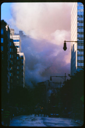 Purple Hues in the Smoke Post Attack, Pedestrians and Rescue Workers Face the Wreckage.jpg