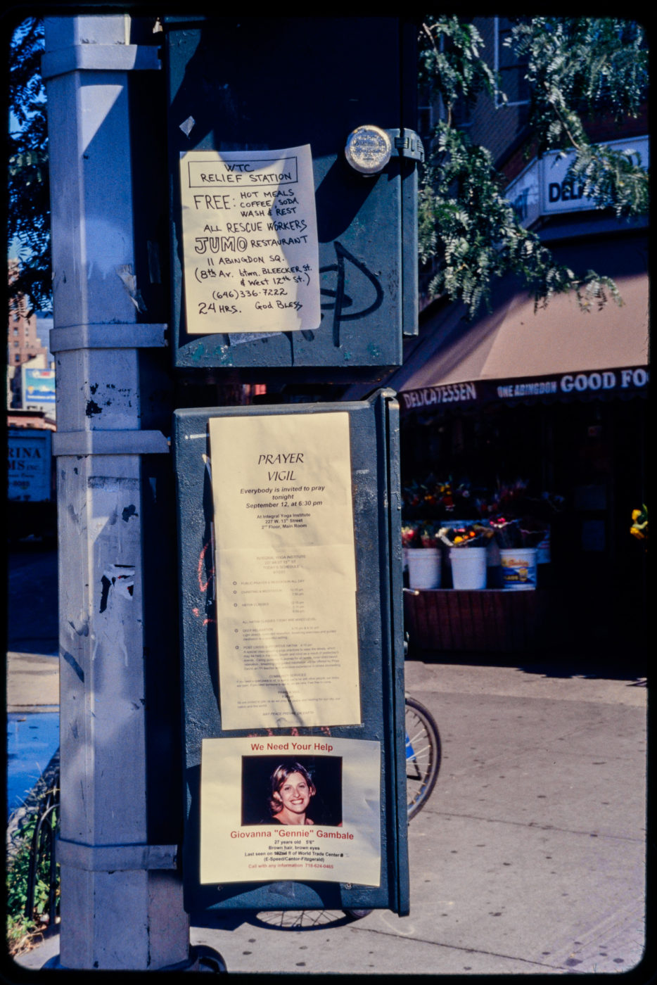 Relief Station, Vigil, and a Missing Loved One Advertised on a Phone Box Outside One Abingdon Delicatessen