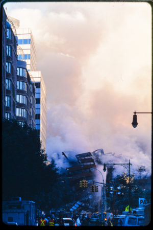 Rescue and Construction Workers with Other New Yorkers and Pedestrians Face the Wreckage and Smoke.jpg