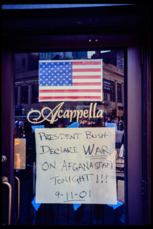 Sign Taped to the Front Window of Acappella on Hudson Street Demands that President Bush Declares War on _Afganastan_ Tonight, 9-11-01.jpg