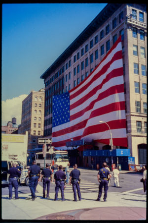 Six Police Officers Look Up at Enormous American Flag at Hubert and Greenwich Streets.jpg