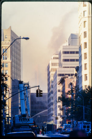 The Effort Continues to Extinguish the Smoke Rising from the Wreckage.jpg