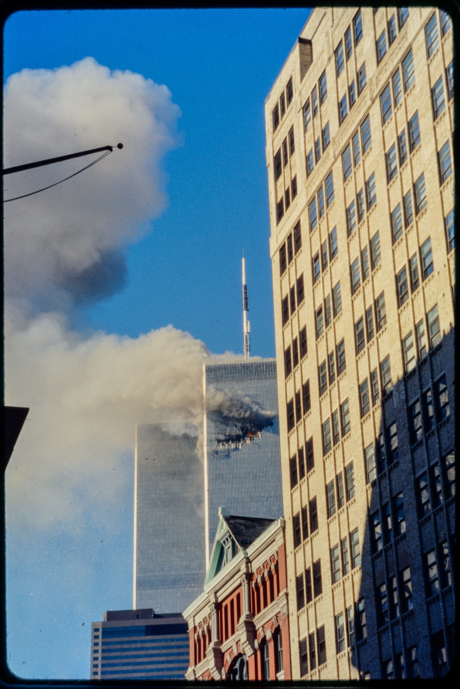Tower 1 burning from Hudson and Franklin 99 Hudson in Foreground.jpg