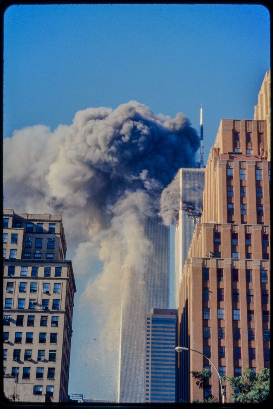 Tower 2 Getting hit by Plane as Tower 1 Burns.jpg