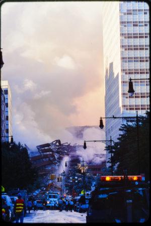 Truck Driving Up Greenwich St as Workers and Pedestrians Cross Near Destruction Above Warren St