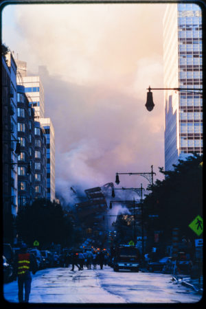 View of Pedestrains and Workers Watching WTC5 Fall from Greenwich St north of Duane St.jpg
