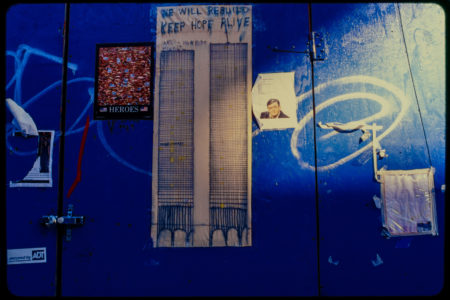 We Will Rebuild Keep Hope Alive Artwork and Other Flyers on Blue Door.jpg