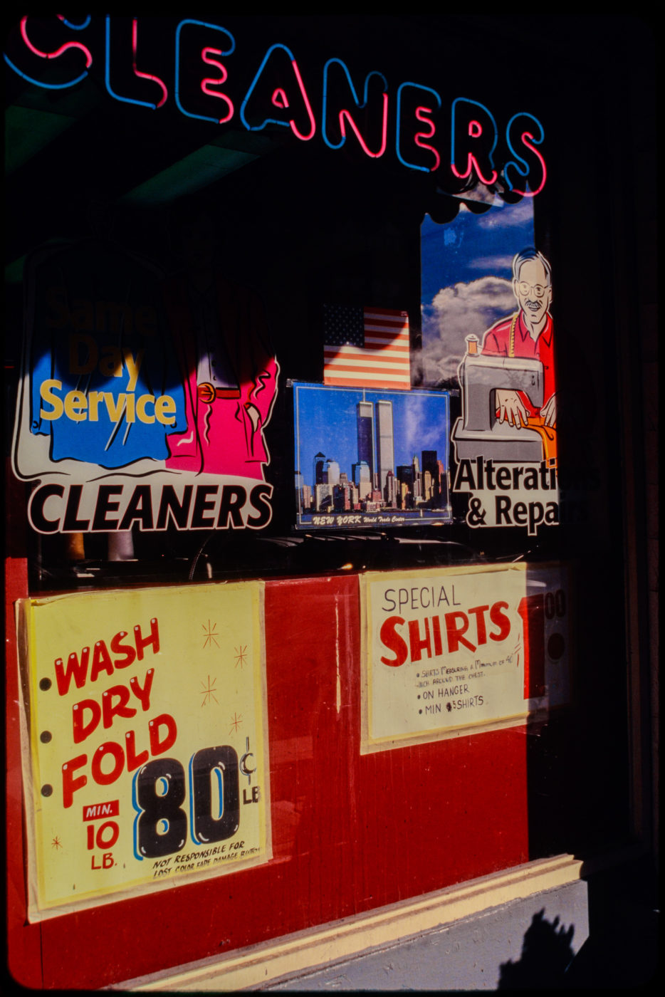 Window of a Dry Cleaners, Closer Shot, Sign says 80 Cents Per Pound of Laundry.jpg