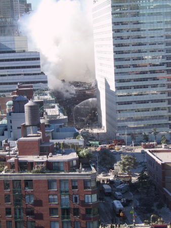 Ariel View from 335 Greenwich Street of Firefighters Working on the Grund to Put out Fires at Destroyed WTC .JPG