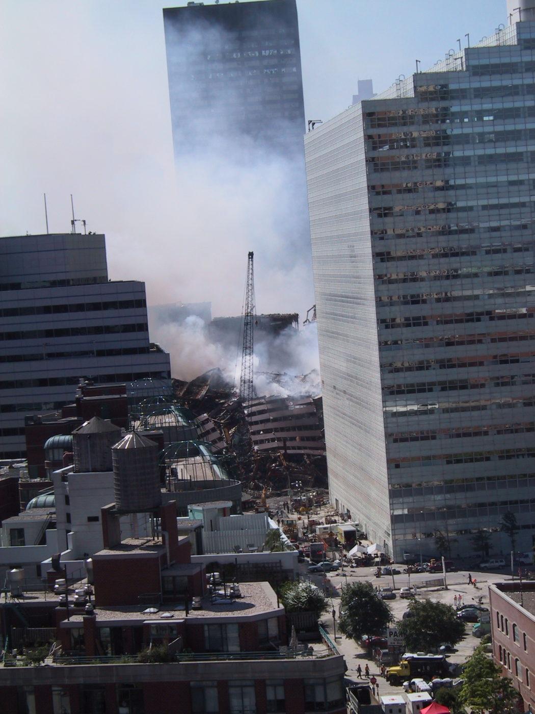 Crane Working Through Smoke at WTC3 from Greenwich Street.JPG