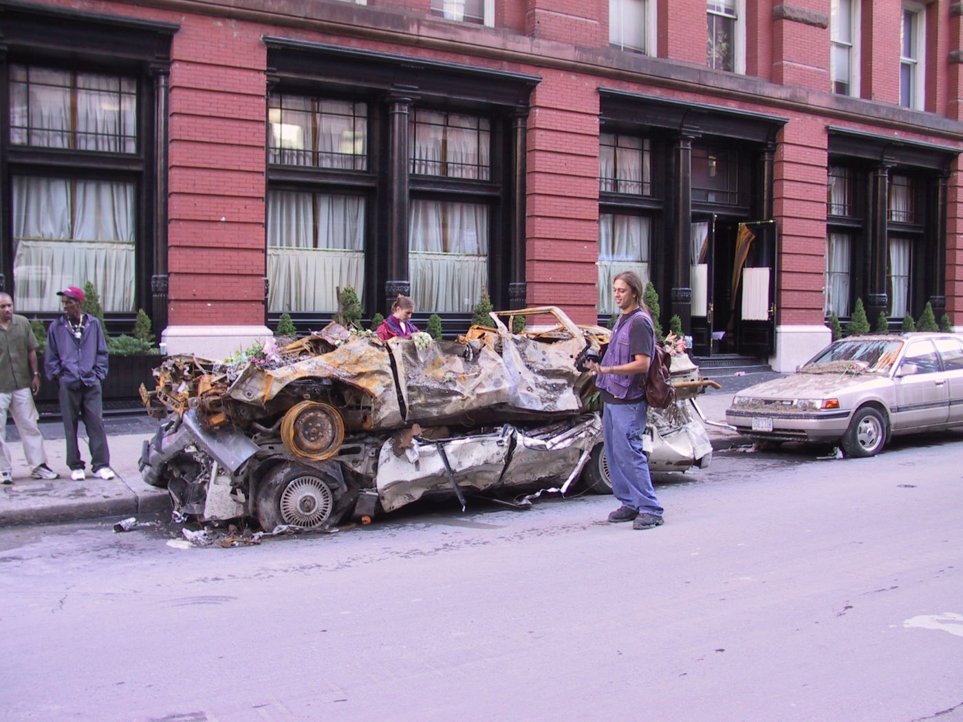 Crushed Cars Piled on top of Eachother.JPG