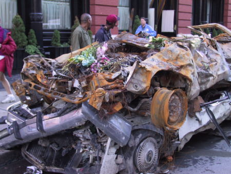 Flowers Laid on Crushed Cars.JPG