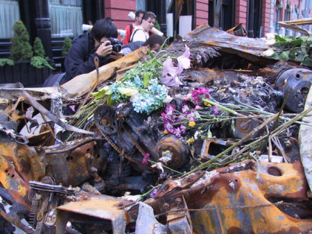 Flowers on top of Destroyed Carss