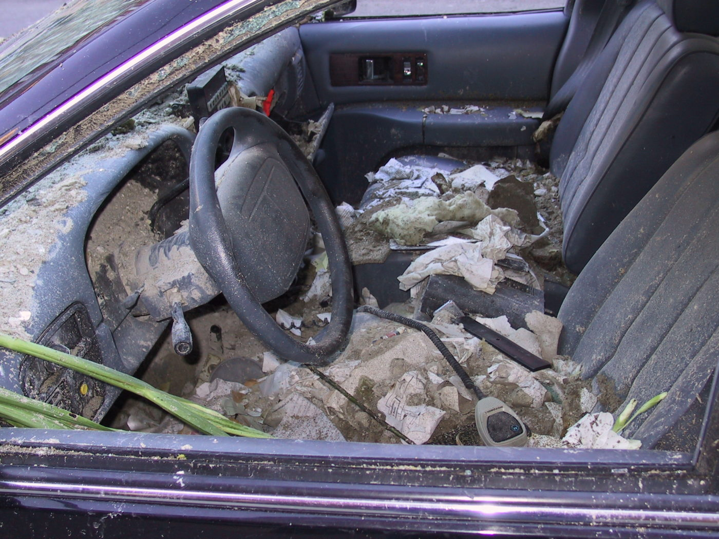 Front Seat of a Police Car with a Police Scanner Covered in Dust .JPG
