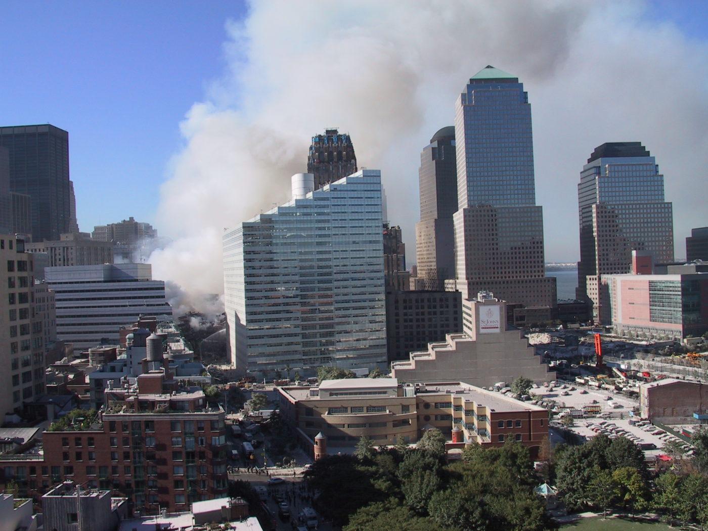 Smoke Rising Above 275 Greenwich Street, 200 Vesey Street and WTC3.JPG