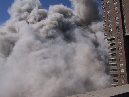 Thick Smoke Rising Against 310 Greenwich Street as seen from 335 Greenwich Street as the Towers Collapse.JPG
