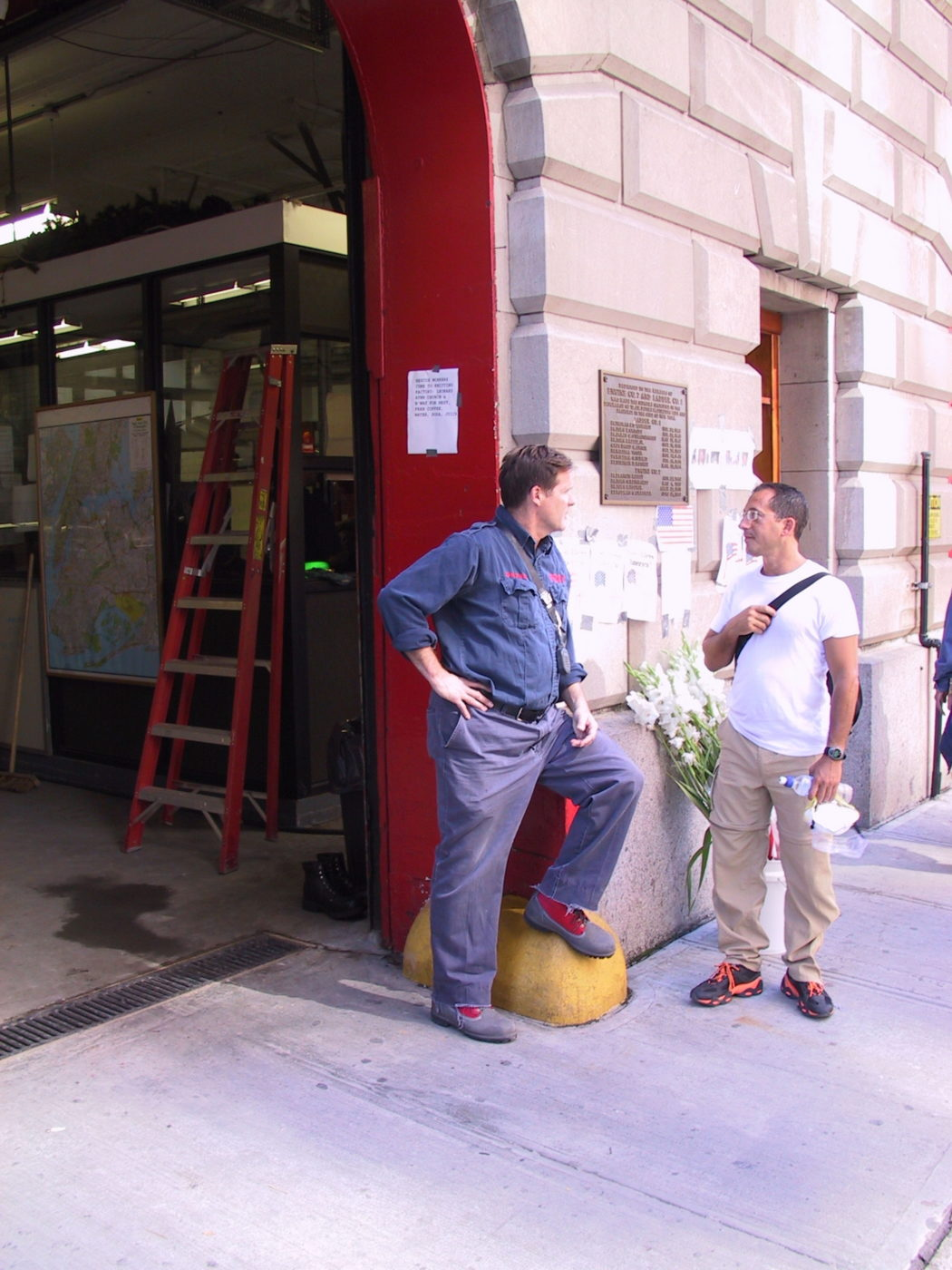 Unknown Firefighter Talking to an Unknown Man Outside of Engine 7.JPG