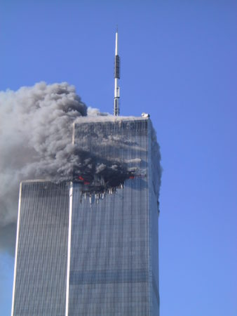 Wider View of Smoke Rising from the Visible Hit of the Plane at WTC1.JPG