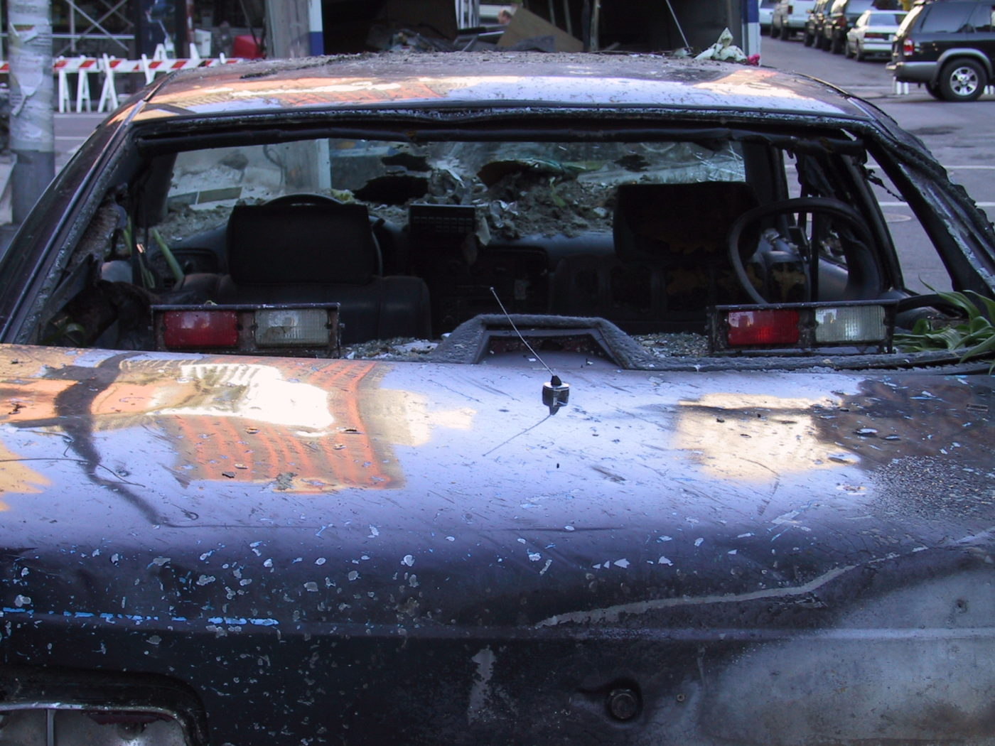Windows of a Car Destroyed covered in Dust.JPG